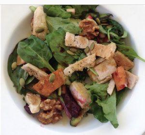 A Bowl of Salad with Sliced Port Fillet
